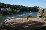 Kayakers approach Willamette Falls along the Blue Heron Paper mill site in Oregon City.