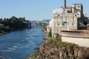 The Blue Heron Paper Co. mill is on the Oregon City side of the Willamette River. The circular structure in the foreground is a water treatment plant. Oregon City's new bridge is in the distance.