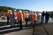 Portland-area civic leaders pause to admire Willamette Falls during a tour of the Blue Heron Paper Co. site in Oregon City.