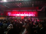 Media, public officials and current WWE trainees (far left) all watch as the WWE Performance Center officially opens.