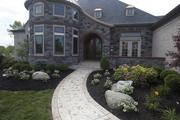 Justin Doyle Homes has three houses in Homearama 2013. The walk leading to the entrance of The Chateau D'Avoise includes unique brick and stone work.