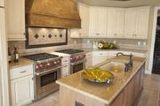 The kitchen in the Chateau D'Avoise features two Wolf gas ranges.