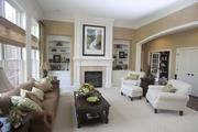 A spacious family room is adjacent to the kitchen in The Alexis by W.V. deStafano Homes LLC.