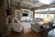 A large living room with lots of natural light is in The Carolina.