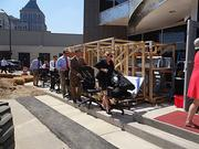 Charles Aris employees paraded their chairs from the old office to the new building as they relocated last year to their new headquarters in downtown Greensboro.