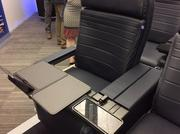 United's new premium cabin seat is just over an inch wider than the current seat.