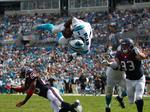 Cam Newton's flying touchdown and more scenes from the Carolina Panthers' home opener (PHOTOS)