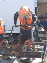 Grinding off the edges of a molten steel joint makes for a smooth ride on the FasTracks East line between downtown and Denver International Airport.