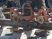 Sparks fly as a welded steel joint between segments of the FasTracks East rail line is smoothed.