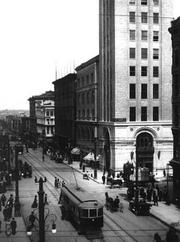 A 1912 photo by L.C. McClure shows 16th Street and the lower part of the Daniels & Fisher tower.