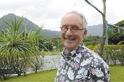 Mitch D'Olier stands on the edge of Kailua, with the Koolau Mountains in the background. He has been president and CEO of Kaneohe Ranch Co. LLC and the Harold K.L. Castle Foundation since 2002.
