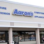 How high did Aaron's Inc.'s profit go in 2015?