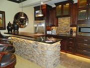 Rock Springs Home 5: Lower level bar made of stone with a copper top suspended above the countertop