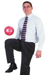 """Jeff Yoakum -Vice president, Bank of America """"The pink soccer ball seems an odd choice but represents the many long-term friends I have today because of soccer, and the color represents my opportunity to coach my daughter."""""""