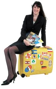 """Ann Anderton Warren -Senior human resources specialist, city of Wichita """"I chose a suitcase and a few books bought on my travels to represent me. I love to travel and to read, as both open your eyes to new experiences and make you a better citizen of the world."""""""