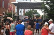 Red Sammy of Baltimore performs on the North Avenue stage on Sunday of Artscape.