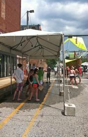 A misting tent at Artscape. Temperatures surpassed 90 degrees daily throughout the three-day festival.