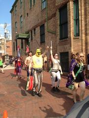 The Baltimore Rock Opera Society marches down Charles Street as part of Artscape.