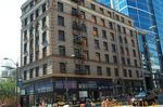 Seattle developer Urban Visions ties up landmark building near Pike Place Market