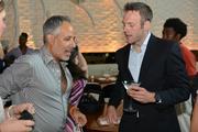 Fashionado owner Vincent Martinez, left, chats with author Jeff Wilser.