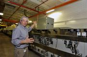 Jeremy Bowen, director of operations for Snyder's-Lance Inc., shows the snack maker's new ovens.