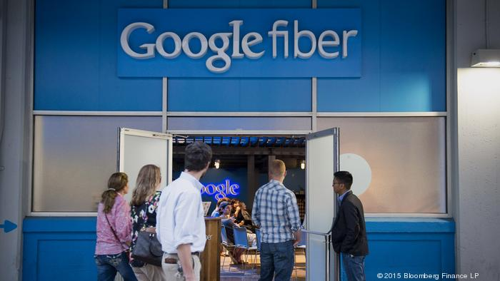 Pedestrians walk past Google Inc.'s Fiber Space in downtown Austin, Texas, U.S., on Saturday, April 4, 2015. About 900,000 people live in the city of Austin and that number is expected to reach nearly 1.3 million by 2040, a 40 percent increase, according