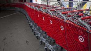Shopping carts sit lined up at a Target Corp. store in Seattle, Washington, U.S., on Thursday, May 14, 2015. Target Corp. is scheduled to release earnings figures on May 20. Photographer: David Ryder/Bloomberg