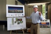 Tom Haines, general manager of the Epicurean, shows the finished hotel drawing and layout.