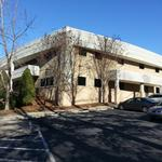 Real estate investors buy, sell UNC office buildings in Carrboro for $9 million