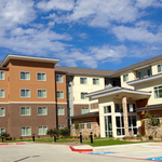 First hotel opens in Springwoods Village near Exxon campus