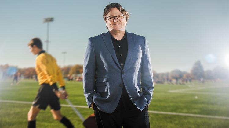 Shane Hackett went from playing soccer to directing the nation's largest youth soccer league. The association now is branching out into futsal, a variation of soccer usually played indoors..