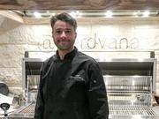 Mike Junio stands in front of the grill at @nerdvana, which will include a restaurant and cafe.