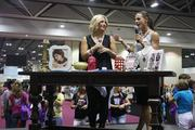 Silpada Designs co-presidents Kelsey Perry, left, and Ryane Delka speak on a livestream of the jewelry party for representatives who couldn't come to the national conference at the Kansas City Convention Center.