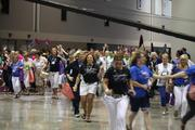 Silpada sales representatives rush in to the jewelry party at the company's annual national conference at the Kansas City Convention Center.