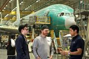 1. The Boeing Co. employed 85,000 people full-time in 2012 in Washington state. Among them were, from left, Jese Hake, Rob LaJudice and Frank Vargas III, photographed at the Boeing plant in Everett. The 777 manufacturing line is in the background.