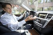 Mercedes-Benz Research & Development North America President & CEO Johann Jungwirth explains an in-car app system using cloud computing, which is known as Embrace.