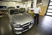 """Jungwirth shows off one of the automaker's self-driving cars, which the German company first began experimenting with in the mid-1990s. Jungwirth said Mercedes slowed research in the area because government regulators and consumers """"weren't ready"""" for the technology at the time."""