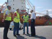 Brian Taylor, CEO of the Jacksonville Port Authority, talks with longshoremen working on the port's docks.