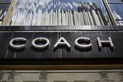 Coach Inc. signage is displayed outside a store in New York.
