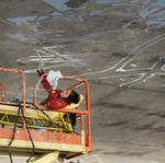 Take a peek at artists painting giant mural under a Sacramento freeway (slideshow)