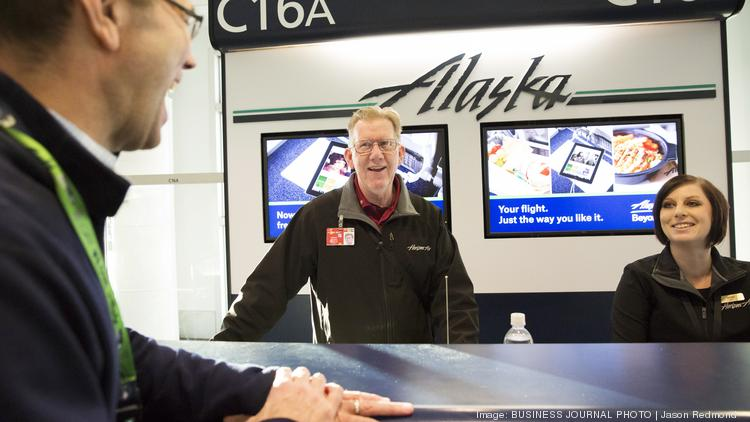 alaska airlines ceo brad tilden talks to customer services agents greg simmons and jacqui nelson as