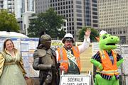 Rennaissance Festival actors and the Knights mascot Homer greet media arriving for an event announcing the opening date for BB&T Ballpark.