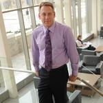 Xavier's business dean to step down