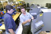 FireKing Security Group's Roger Dowden, inventory control coordinator, left, and Mike Smith, vice president - research and development, are shown in this 2006 photo. The company's main products and services include fire-proof file cabinets, safes and security products. With 350 workers, the company ranked No. 12 on Business First's 2012 list of the area's largest manufacturing firms.