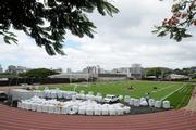 Workers install new turf at Punahou School's Alexander Field.