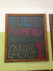 Chalkboard announcing Full Pint Brewing's pub becoming a licensed brewpub. The brewery began offering a full menu of food starting Aug. 1 and now can sell its beers by the glass, along with selling it by the growler, six pack, case and keg.
