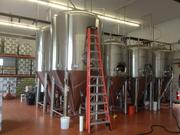 Tanks at Full Pint Brewing. Kristophel put the equipment investment at Full Pint at $500,000.