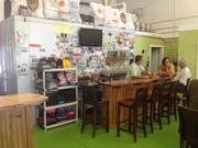 The bar at Full Pint Brewing. Owners Mark Kegg and Barrett Goddard hang out with a regular.