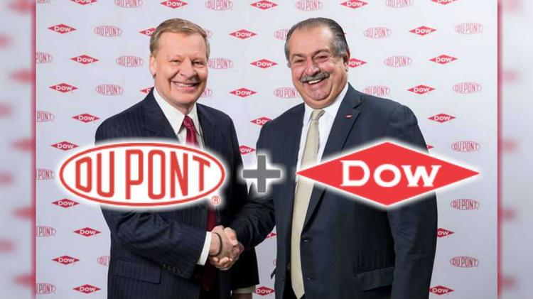 DuPont CEO Ed Breen (left) with Dow Chemical CEO Andrew Liveris after announcing their companies' merger into DowDuPont.