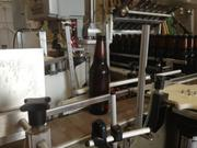 A new bottle of beer rolls off the line.